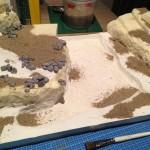 Zand op verschillende plaatsen aangebracht
